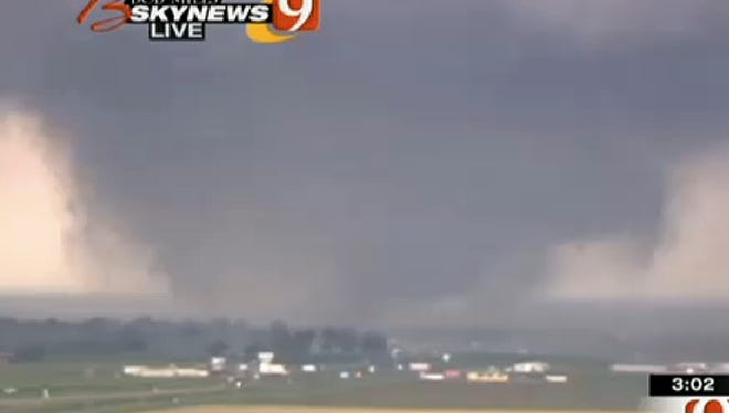 A tornado roars near Oklahoma City on May 20, 2013. Other than a stormy couple of weeks at the end of May, the 2013 tornado season was quite calm.