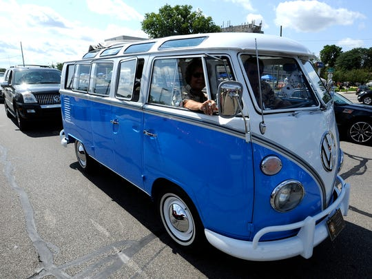 A VW 21-window Samba Bus rolls down Woodward Avenue on Saturday.