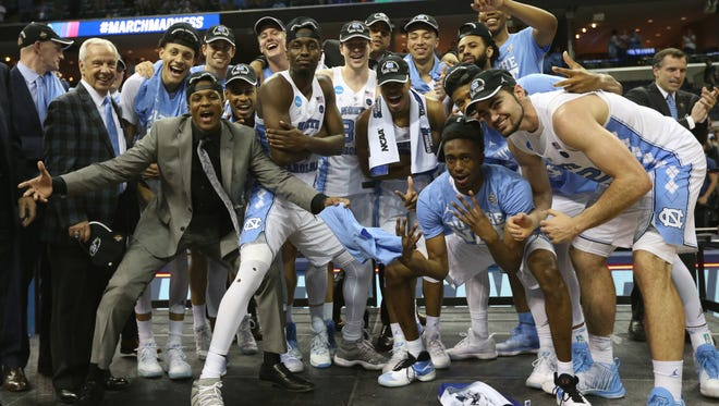 The North Carolina Tar Heels celebrate after defeating the Kentucky Wildcats in South Regional finals of the 2017 NCAA Tournament.