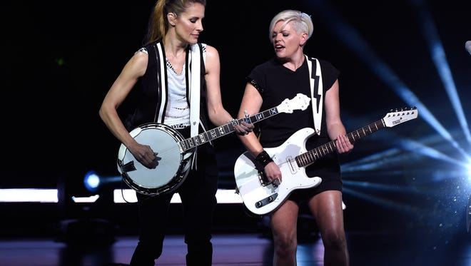 Emily Strayer and Natalie Maines of the Dixie Chicks perform onstage during the DCX MMXVI World Tour in June. Photographers were not allowed at the KFC Yum! Center show.