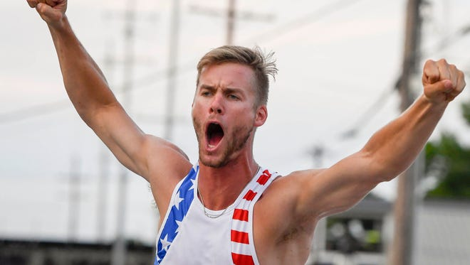 "Scott Houston reacts to clearing 18'-2""1/2 at the Jammin' & Jumpin' Street Vault event at the Henderson riverfront Tuesday. The former Indiana University and University of North Carolina pole vaulter won the event in it's eleventh year, July 4, 2017."