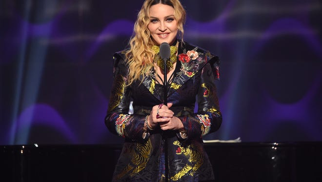 FILE - FEBRUARY 07: Singer Madonna has reportedly adopted 4-year old twin girls from Malawi. NEW YORK, NY - DECEMBER 09:  Madonna speaks on stage at the Billboard Women in Music 2016 event on December 9, 2016 in New York City.  (Photo by Nicholas Hunt/Getty Images for Billboard Magazine) ORG XMIT: 690205223 ORIG FILE ID: 628787872