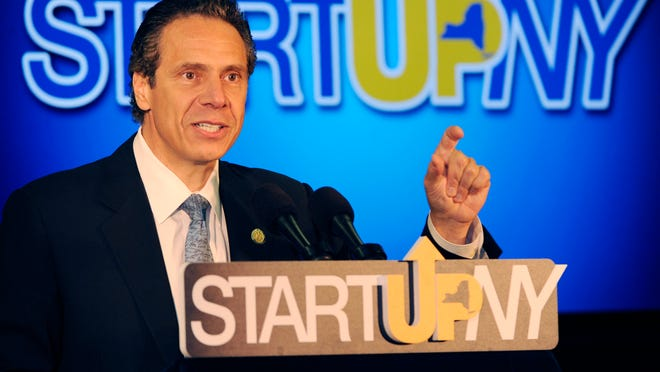 Gov. Andrew Cuomo makes a point about the creation of jobs in Western New York during a press conference at the University of Buffalo's South Campus on Monday, July 28, 2014, in Buffalo, N.Y. Cuomo is defending his handling of an anti-corruption commission, dismissing reports that his administration interfered with its work. Cuomo says the commission made its own decisions and that his office only offered suggestions. Cuomo, a Democrat, created the commission a year ago and dismantled it this spring. (AP Photo/Gary Wiepert)