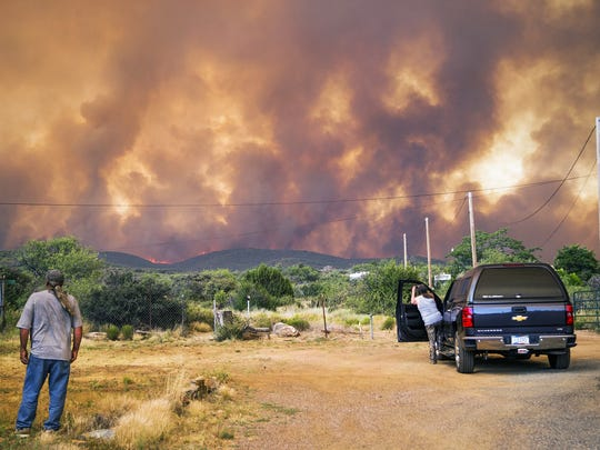 Don Sandy (left) watches the Goodwin Fire as seen from