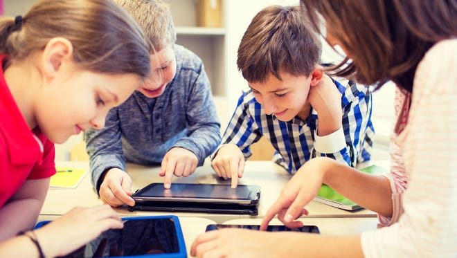 Students using tablet computers.