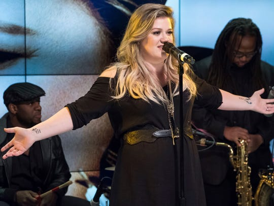 Kelly Clarkson performs at a fan event celebrating