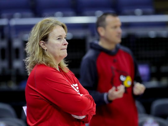 Louisville's  Stephanie Norman, the associate head coach for the Cards, has been with Jeff Walz since he took over the program 11 years ago.