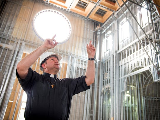 Father David Boettner, ÊSacred Heart Cathedral rector and the Diocese of Knoxville vicar general, points out features inside the Cathedral of the Most Sacred Heart of Jesus located on Northshore Drive in Knoxville.