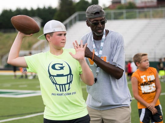 Former Tennessee Vol Tony Robinson coaches on throwing the ball at the Legends of Tennessee 2018 Football camp held at Northview Academy in Kodak, Tenn., on Thursday, June 14, 2018.