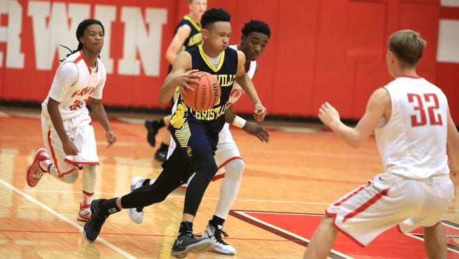 Asheville Christian Academy senior Jordan Shepherd, middle, originally committed to play college basketball for James Madison on Jan. 8, but is now keeping his options open.