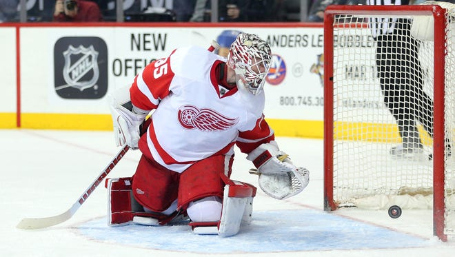Feb 15, 2016; Brooklyn, NY, USA; Detroit Red Wings goalie Jimmy Howard (35) watches as a backhand shot by New York Islanders center Brock Nelson (not pictured) bounces into the goal during the second period at Barclays Center.