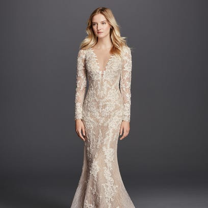 Beaded Venice Lace Trumpet dress  ranging in price from $1,050 to $1,200.