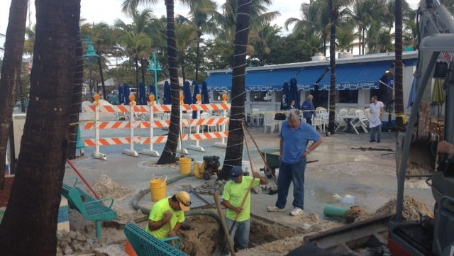 Crews working to fix the fire line of a sprinkler system broken in the Times Square area on Fort Myers Beach