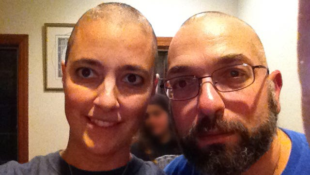 Doctors Amy Reed and Hooman Noorchashm after the start of Reed's chemotherapy treatment. Reed, a Boston doctor, had what she thought was a routine hysterectomy that actually ended up spreading cancer, and making it much worse. She is now campaigning against the procedure she had.