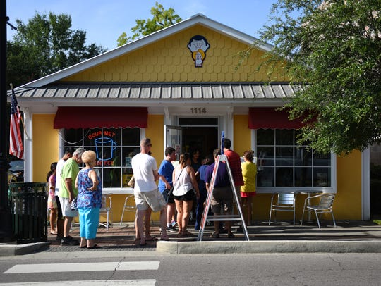 Customers line up for donuts at The TatoNut Donut Shop