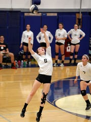 Pawling's Clara Lombardo sets the ball during the Section 1 volleyball Class C finals at Hendrick Hudson High School in Montrose Nov. 4, 2016. Pawling defeated Dobbs Ferry.