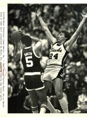Bobby Hansen, right, played in all 33 games for the 1979-80 Iowa men's basketball team. He is now the Hawkeyes' radio analyst.