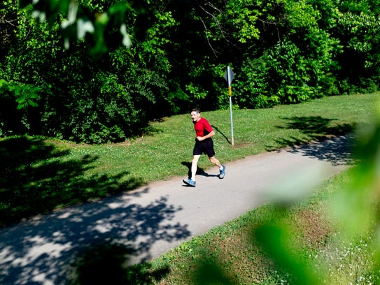 A runner jogs down the Third Creek Greenway in Knoxville