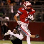 South Salem High School's Gibson Hohberg cruises to a touchdown after making a catch during their game with Sprague on Thursday, Oct. 8, 2015.