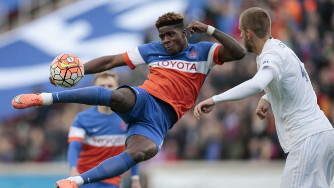 FC Cincinnati forward Sean Okoli (9), left, scores the first goal of the game on a scissor kick in the first half during the USL soccer game between the Charlotte Independence (1-1-0) and FC Cincinnati (1-1-0), Saturday, April 9, 2016, at Nippert Stadium in Cincinnati. The goal marked the first-ever goal for FC Cincinnati at home.