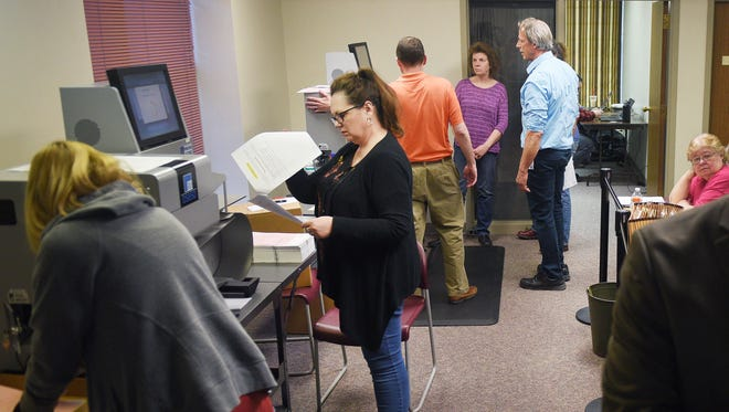 Voting ballots are dropped off at the County Admin Extension building Tuesday, April 10, in Sioux Falls.
