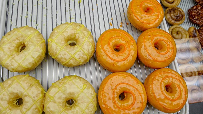 Glaze 'n Daze Donuts come in glazed varieties including Pineapple Coconut and Orange. They are artisanal little cakes but also light as air.