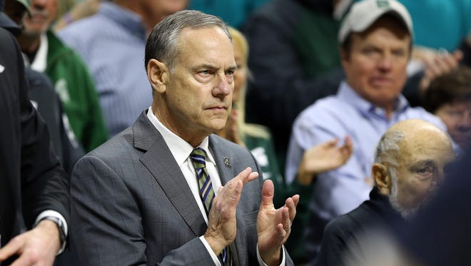 Michigan State Spartans football coach Mark Dantonio looks on from the stands during the first half at Jack Breslin Student Events Center.
