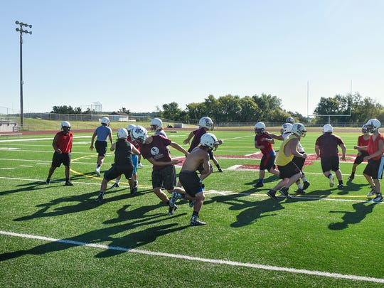 Sauk Centre Mainstreeters run a play during an early morning practice Wednesday, Aug. 17, at the high school.