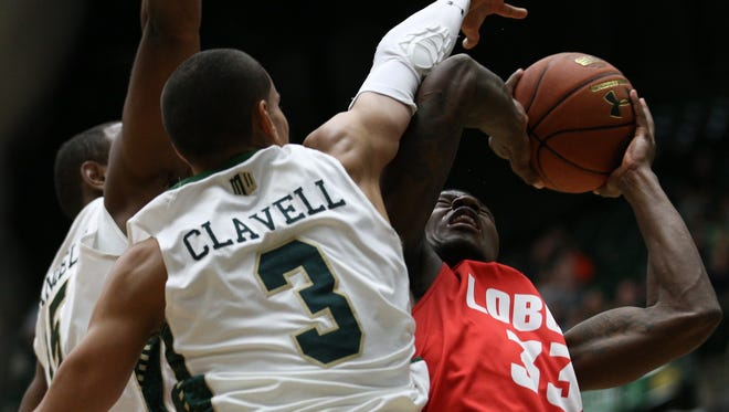 CSU''s Tiel Daniels and Gian Clavell (3) force New Mexico's Deshawn Delaney to alter his shot during Tuesday night's  game at Moby Arena.
