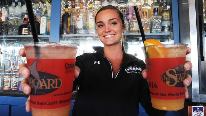 Wilmington's Eileen Marge serves up Orange and Grapefruit Crushes at The Starboard earlier this year.