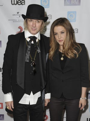 Michael Lockwood and Lisa Marie Presley attend an awards show in 2012. Presley says her estranged fourth husband has hundreds of inappropriate photographs of children on his computer. He says that's a lie.