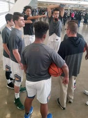 Robert E. Lee senior Jarvis Vaughan, top, and his teammates listen to AAU Blaze head coach Chad Seibert proior to one of their games at the Pittsburgh Hoop Group Jam Fest on Saturday and  Sunday at the David L. Lawrence Convention Center in Pittsburgh, Pa.