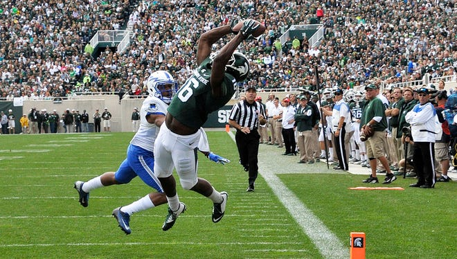 Aaron Burbridge soars for one of his three TD receptions on the day.