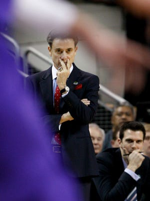 U of L head coach Rick Pitino watches action against Northern Iowa at the KeyArena in Seattle during the third round of the NCAA tournament.March 22, 2015