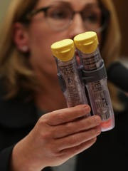 Mylan CEO Heather Bresch holds up a twin-pack of EpiPens