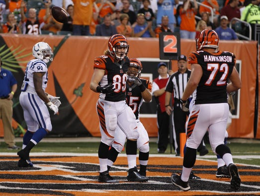 Cincinnati Bengals tight end Ryan Hewitt (89) reacts after his second quarter touchdown during their preseason game against the Indianapolis Colts at Paul Brown Stadium.