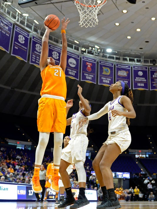 Tennessee center Mercedes Russell (21) shoots for two points in front of LSU guard Chloe Jackson, center, and LSU forward Raven Farley (4) in the first half of an NCAA college basketball game, Sunday, Jan. 28, 2018, in Baton Rouge, La. (AP Photo/Bill Feig)