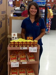 Shelley Johnson at a display stand selling her Mexi-Cajun products at Mac's Fresh Market in Alexandria.