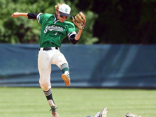 Roxbury's Ryan DiTrolio slides safe under the tag of Pascack Valley shortstop Jake Lutz in the NJSIAA North 1, Group 3 baseball final.