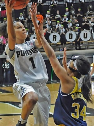 Junior Guard Ashley Morrissette runs a layup against Michigan's Boogie Brozonski Sunday as the Boilers fell to the Wolverines.