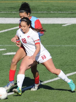 Cooper's Judith Macias (18) battles a Lubbock Monterey player for the ball during their District 4-5A game Tuesday, March 20, 2018 at Shotwell Stadium.
