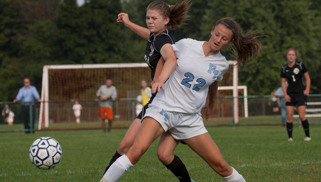 Mideltown North's Kristen Prindeville and Freehold Townships Nicole Sasso battle for a loose ball during Middletown North Girls Soccer vs Freehold Township in Freehold Township NJ on September 18, 2014. . Peter Ackerman /Staff Photographer