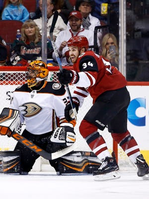 Arizona Coyotes center Zac Rinaldo (34) celebrates a goal against Anaheim Ducks goaltender Ryan Miller, left, by Coyotes' Jason Demers during the first period of an NHL hockey game Saturday, Feb. 24, 2018, in Glendale, Ariz. (AP Photo/Ross D. Franklin)