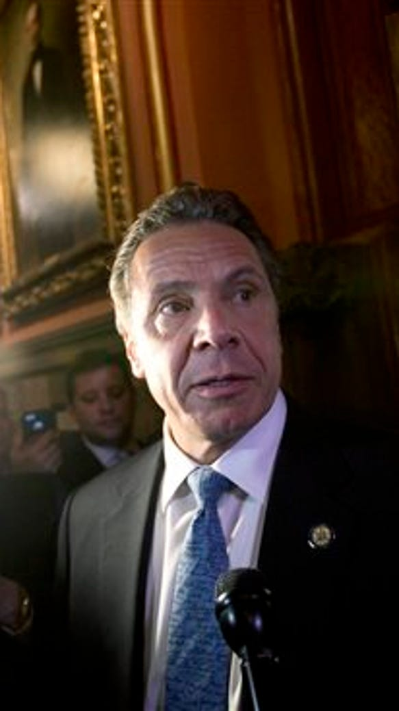 Gov. Andrew Cuomo talks to the media  outside his office