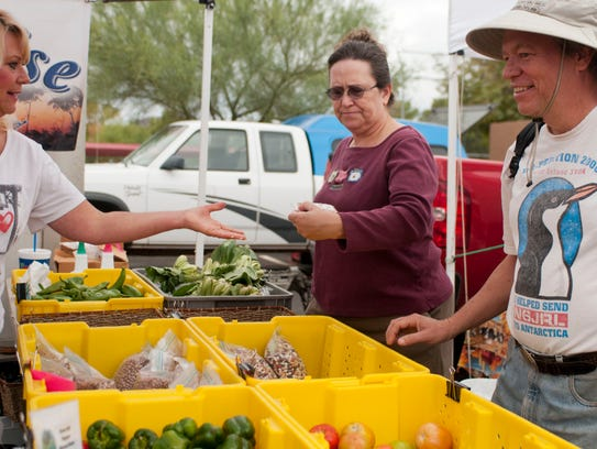 From right, Ron Nelson and Lynette Nelson buy produce