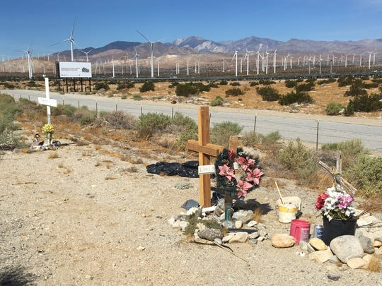 Roadside memorials are visible along Interstate 10, where a tour bus crashed into a big rig Oct. 23, 2016. The collision left 13 people dead and 31 others injured.