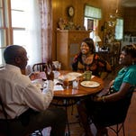A Pew Research Center report found that even more young adults are living at home in 2015 than five years ago. Here, a 2010 photo of then-26 year old Monika Grundy, right, with parents Vel and Art. Monika moved in with her parents in Memphis after losing a job.