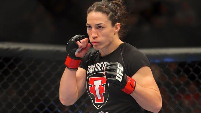 Former McDowell wrestling standout Sara McMann won her latest UFC fight on Saturday night.