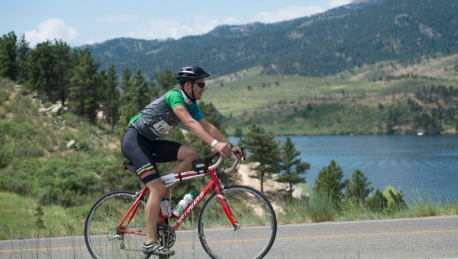 Cyclists travel on N. County Road 23 along Horsetooth Reservoir during Bike MS: Colorado on Saturday, June 24, 2017. Riders traveled up to 100 miles from Westminster on a two-day fundraising bike race to advance research to cure Multiple Sclerosis.