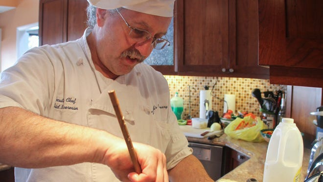Professional chef David Silverman works in a private home in West Long Branch, N.J., on March 20, 2014.